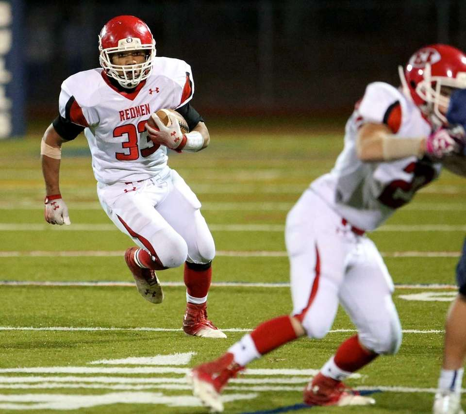 East Islip RB Erik Adon runs for a