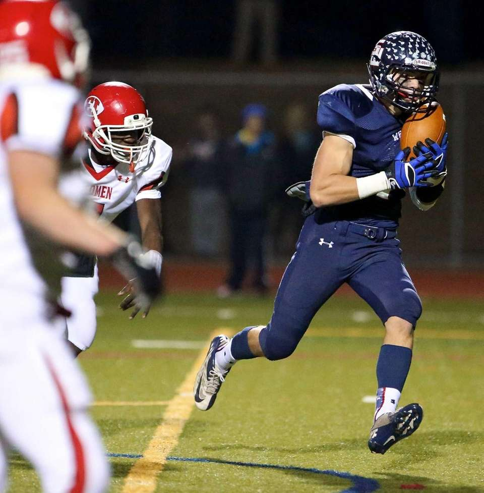 Smithtown West Kyle Mathie grabs the pass and