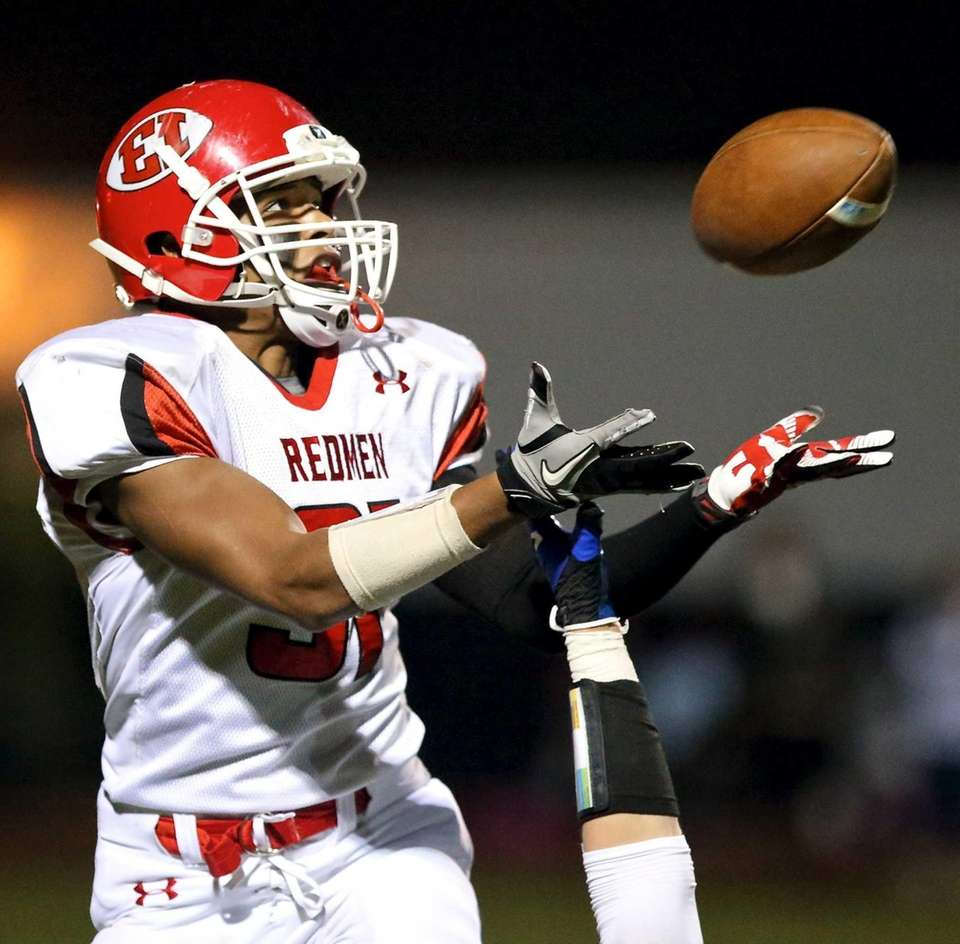 East Islip RB Patrick Valoy attempts a catch