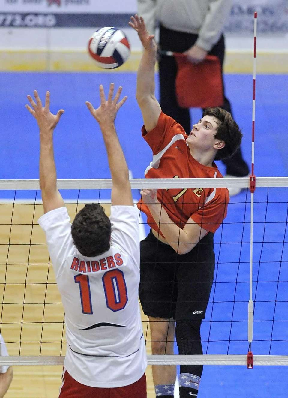 Sachem East's Steve Rodriguez, right, hits against Fairport's