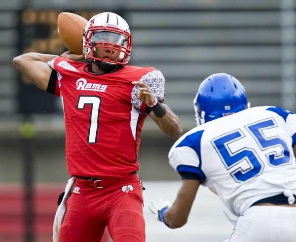Winston-Salem State quarterback Rudy Johnson passes under pressure