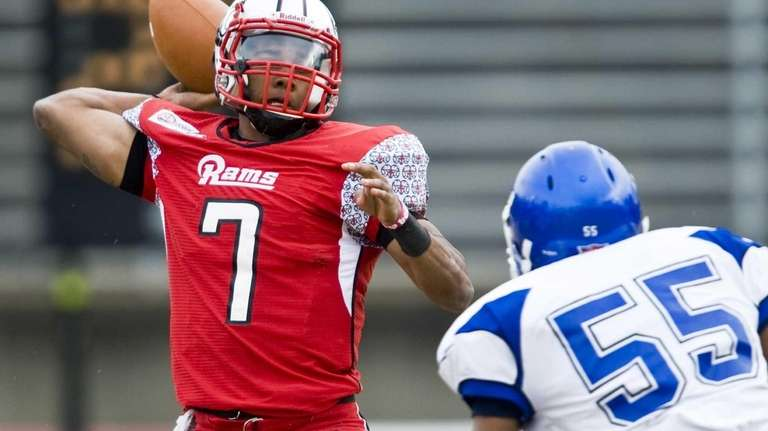 Winston-Salem State quarterback Rudy Johnson passes under pressure