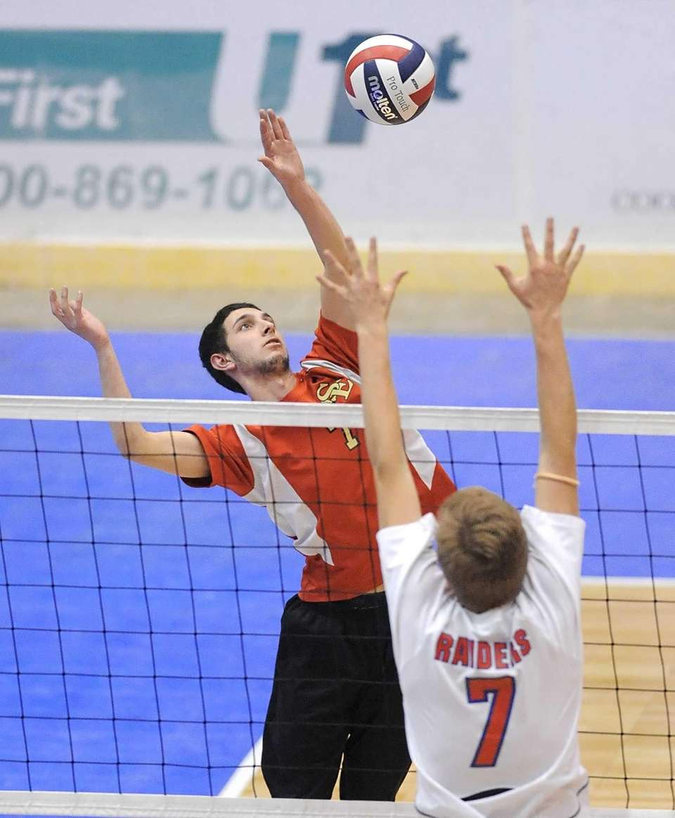 Sachem East's Tyler Jones, left, hits past the