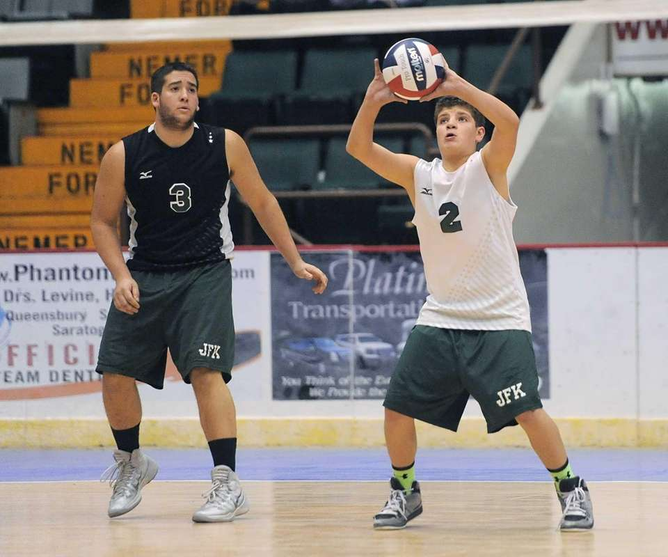 Bellmore JFK's Frank Galiano, right, receives serve next