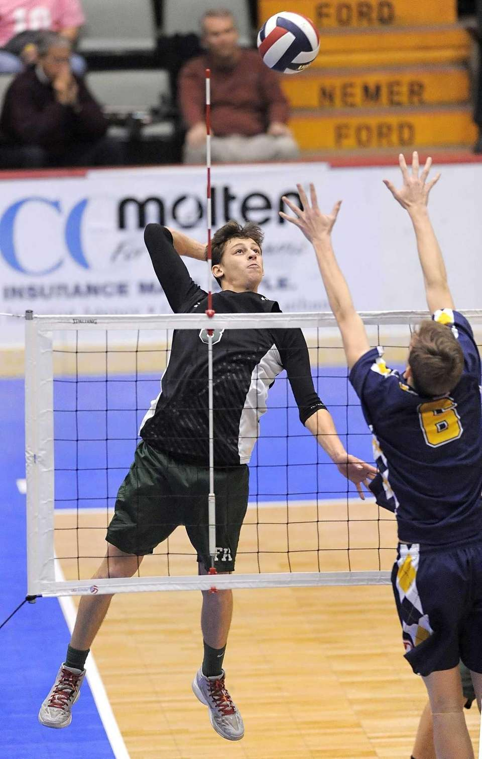 Bellmore JFK's Justin Feigeles hits against Victor's Collin