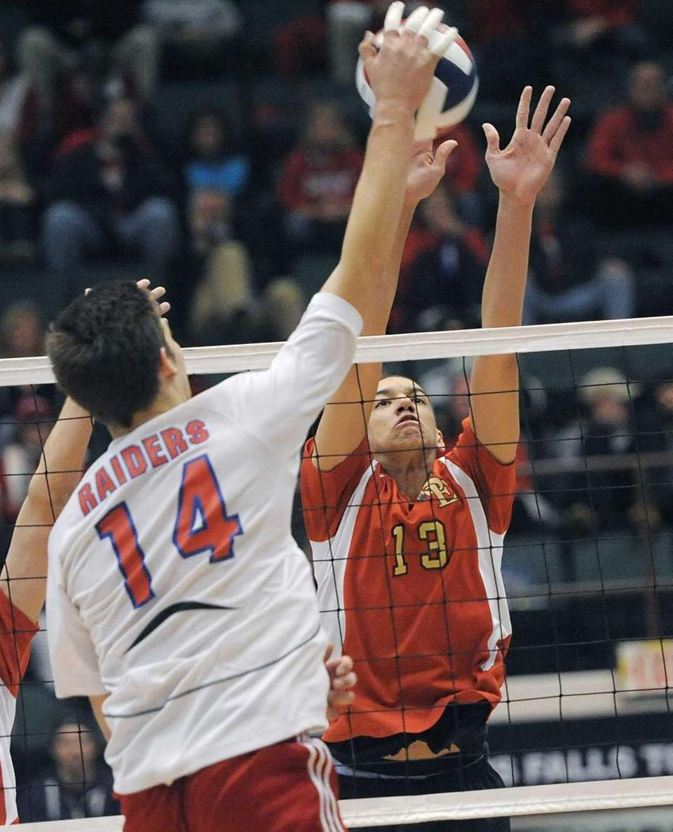 Sachem East's Ryan Cole, right, puts up a