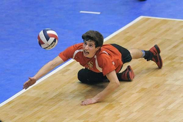 Sachem East's Steve Rodriguez dives for a ball