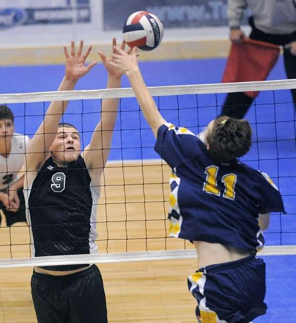 Bellmore JFK's Justin Ganca, left, blocks against Victor's