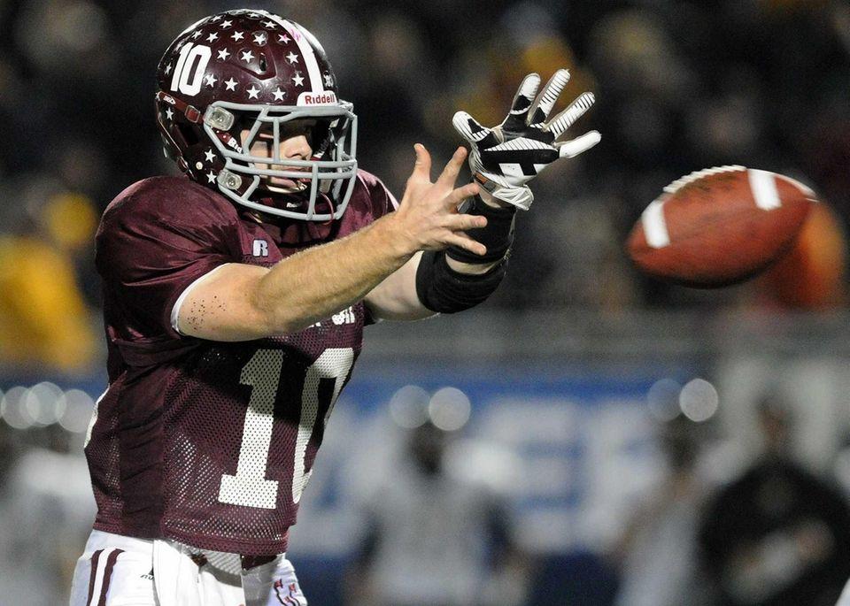Garden City quarterback Brett Stewart takes a snap