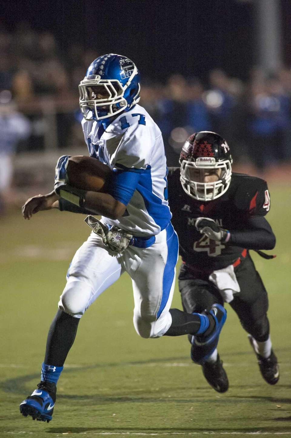 Glenn QB Wayne White, left, tries to avoid