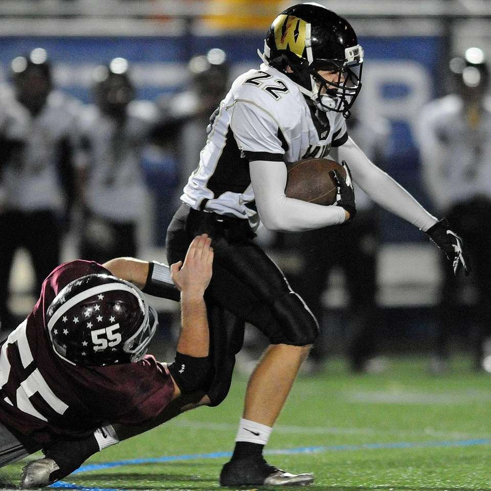 Wantagh's Vinny Vasheo carries the ball during the