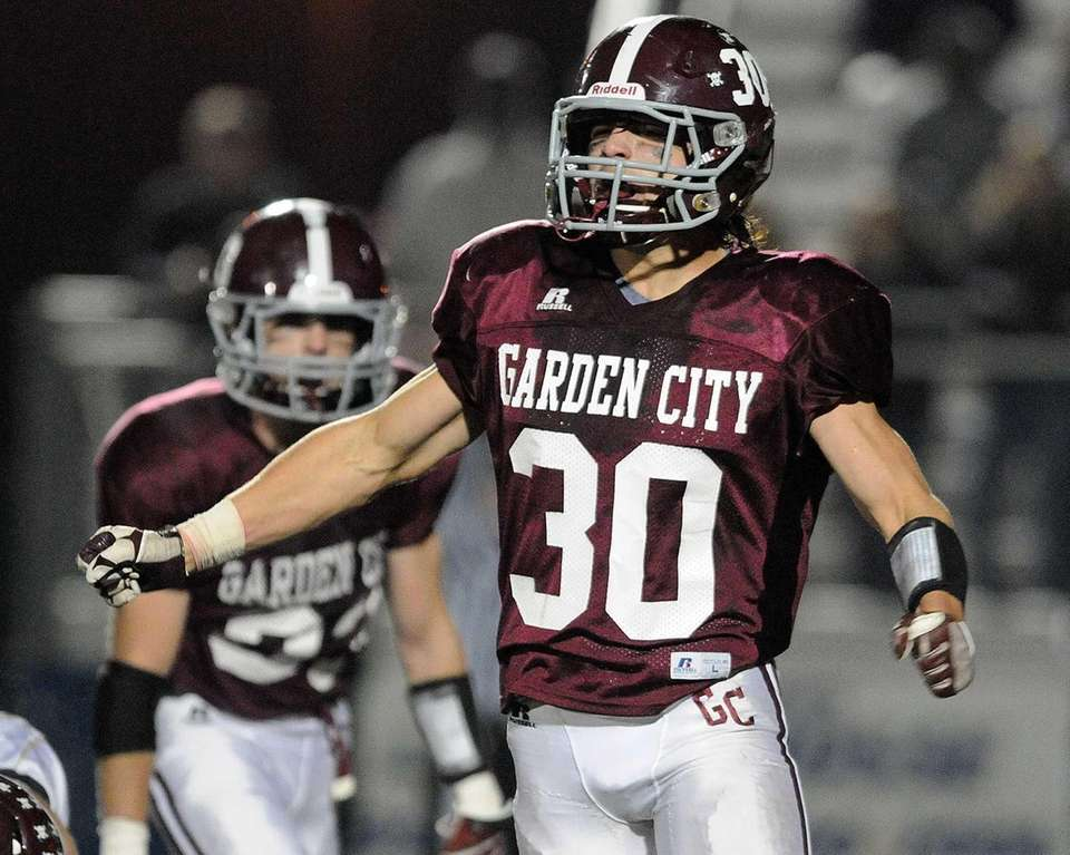 Garden City's James Sullivan reacts after making a