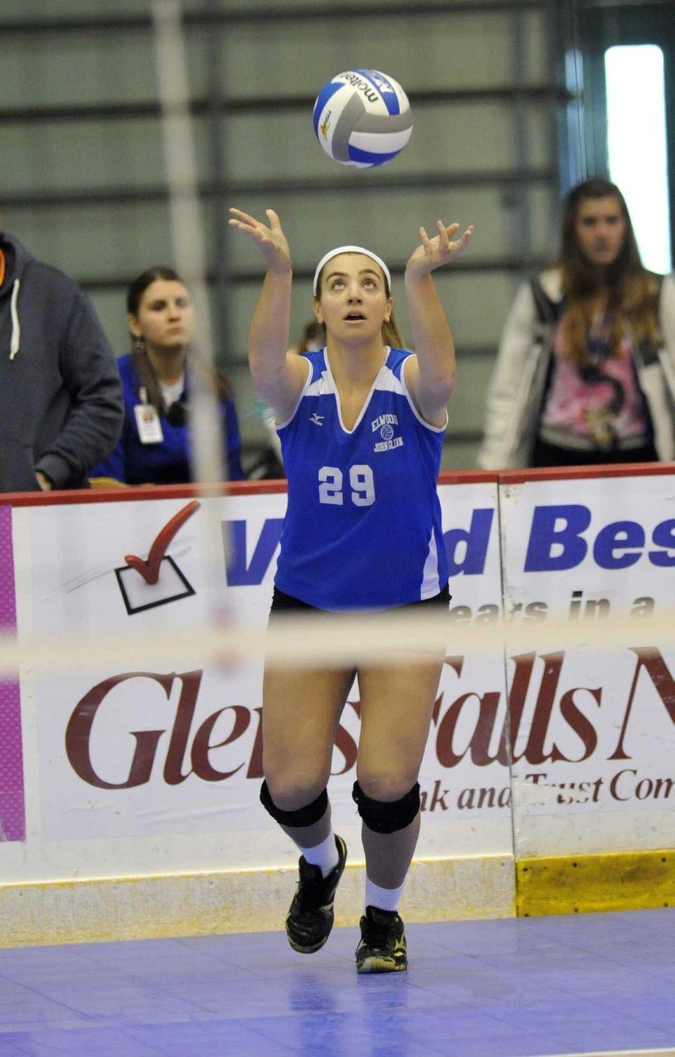 John Glenn's Stephanie Viteritti (29) serves the ball