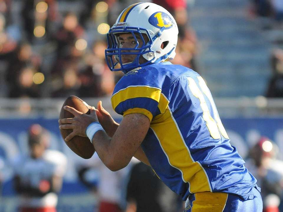 Lawrence quarterback Joe Capobianco drops back to pass