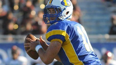 Lawrence quarterback Joe Capobianco drops back to pass