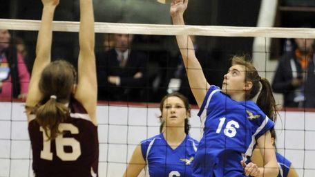 Mattituck's Shannon Dwyer tips the ball over the