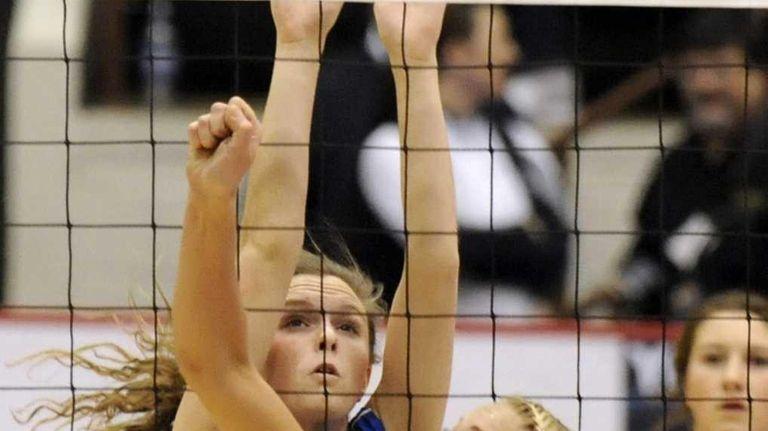 Mattituck's Kayla Healy tips the ball over the