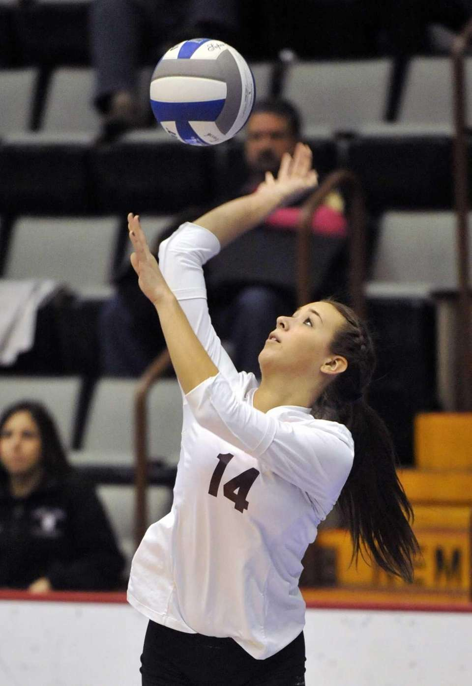 Kings Park's Michelle Sehested (14) blocks the ball