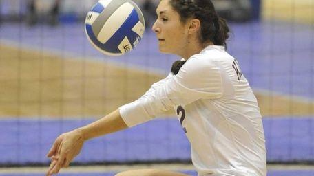 Kings Park's Joelle Goldstein bumps the ball against