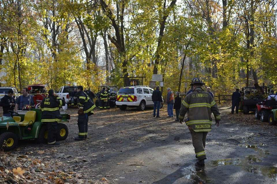 Firefighters assemble at a staging area near Red