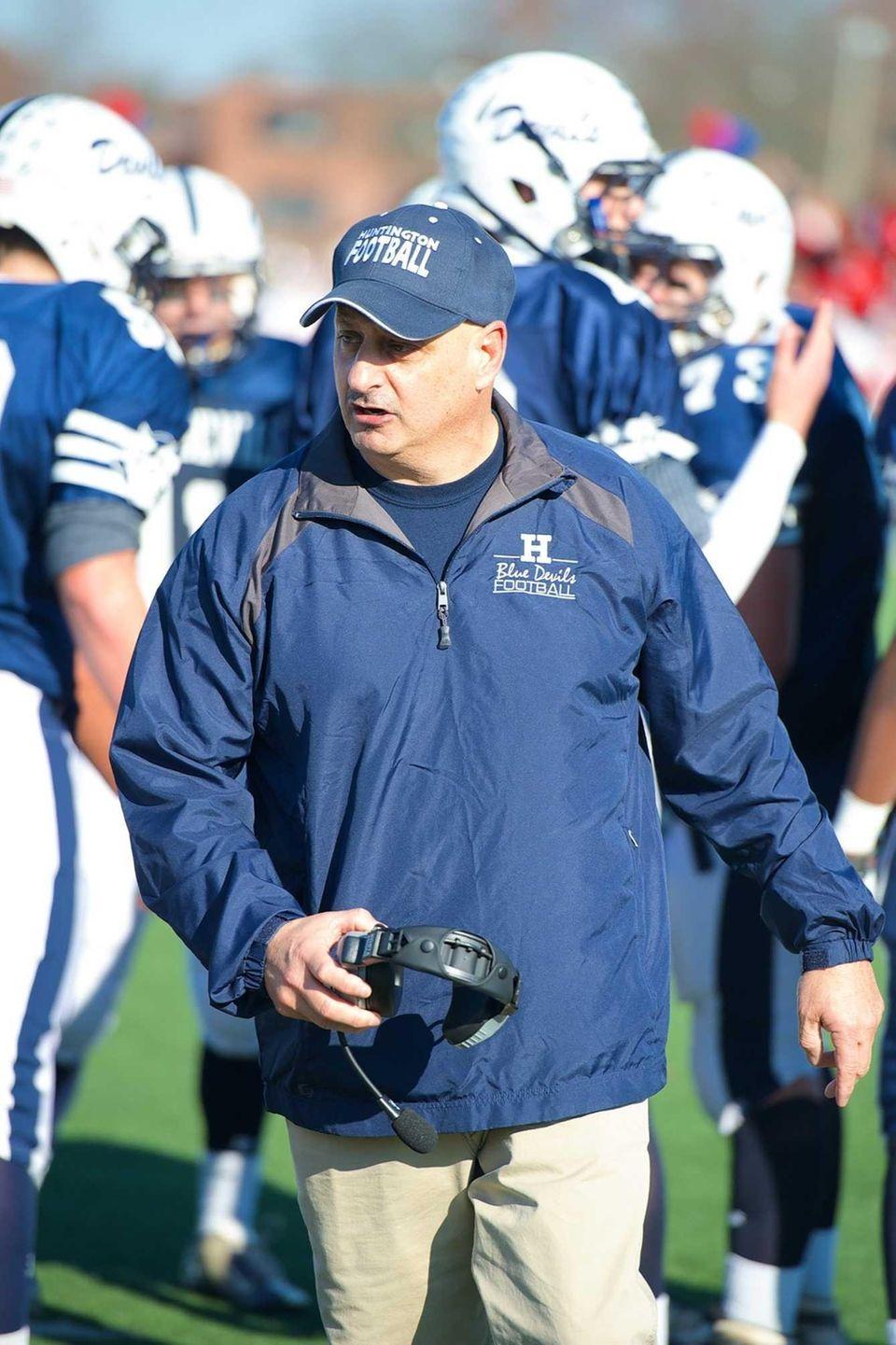 Huntington head coach Steve Muller talks to his