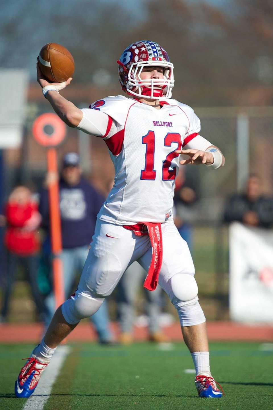 Bellport quarterback Nick Fountis attempts a pass against