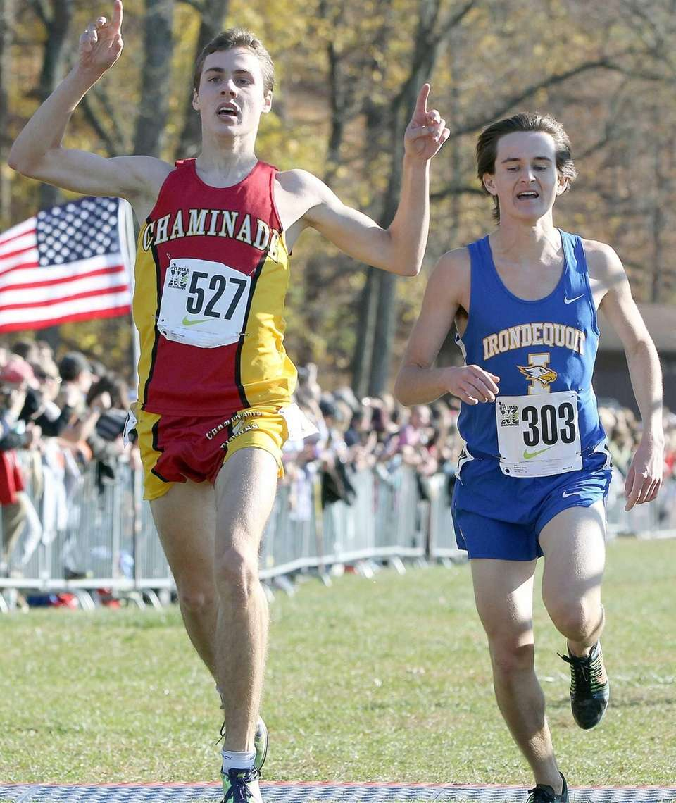 Irondequoit's Josh Dyrland, right, sees Chaminade's Thomas Slattery