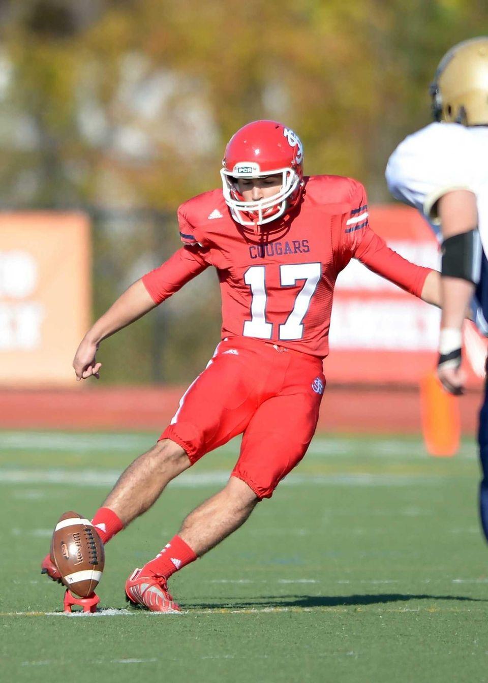 St. John's Nicholas Malderella (17) kicks off to