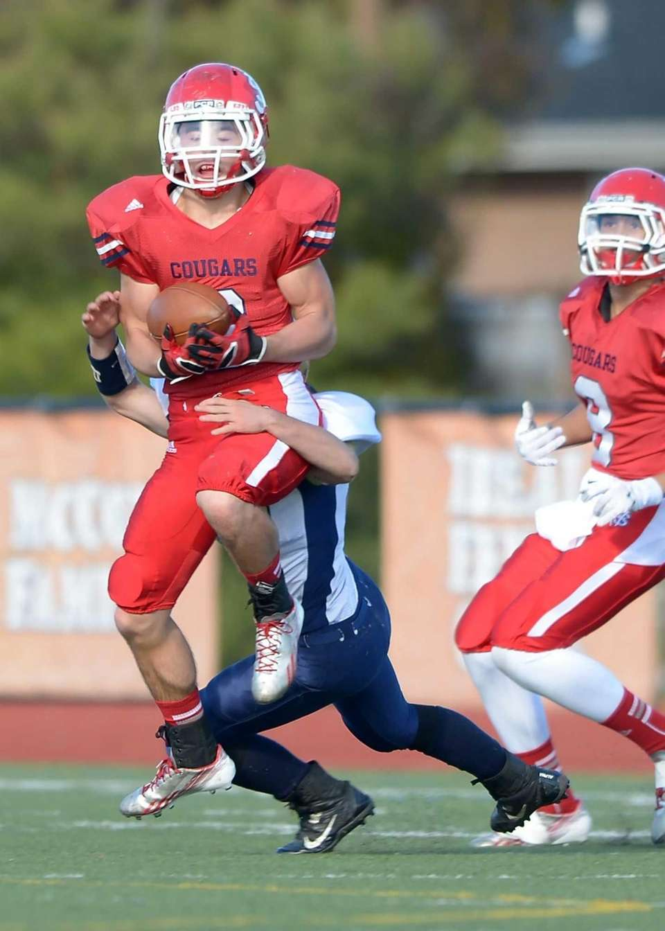 St. John's Kevin DeMaille Jr. (6) intercepts a