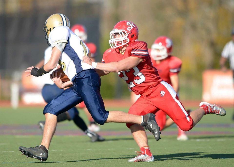 St. John's Lawson Pendergast (23) stops Garrett Murnan