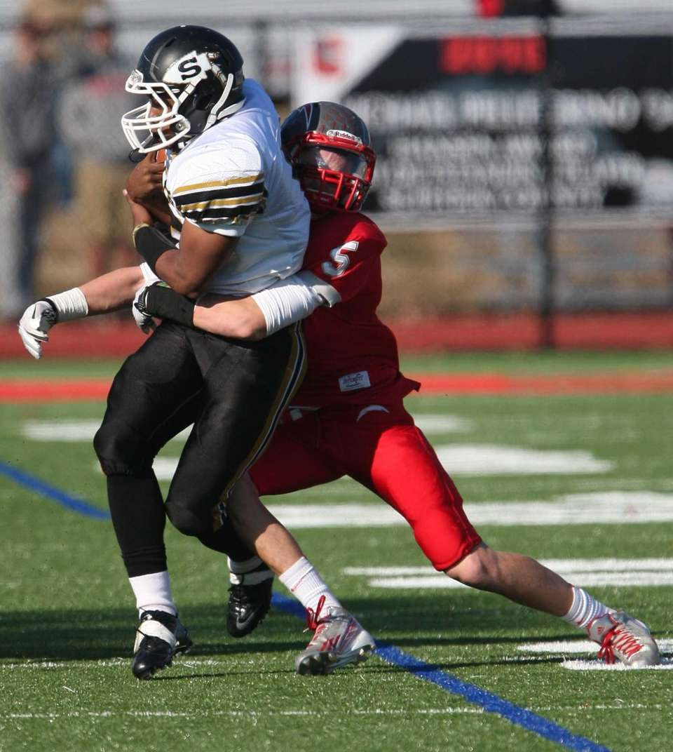 Sachem North's Malik Pierre gets wrapped up by