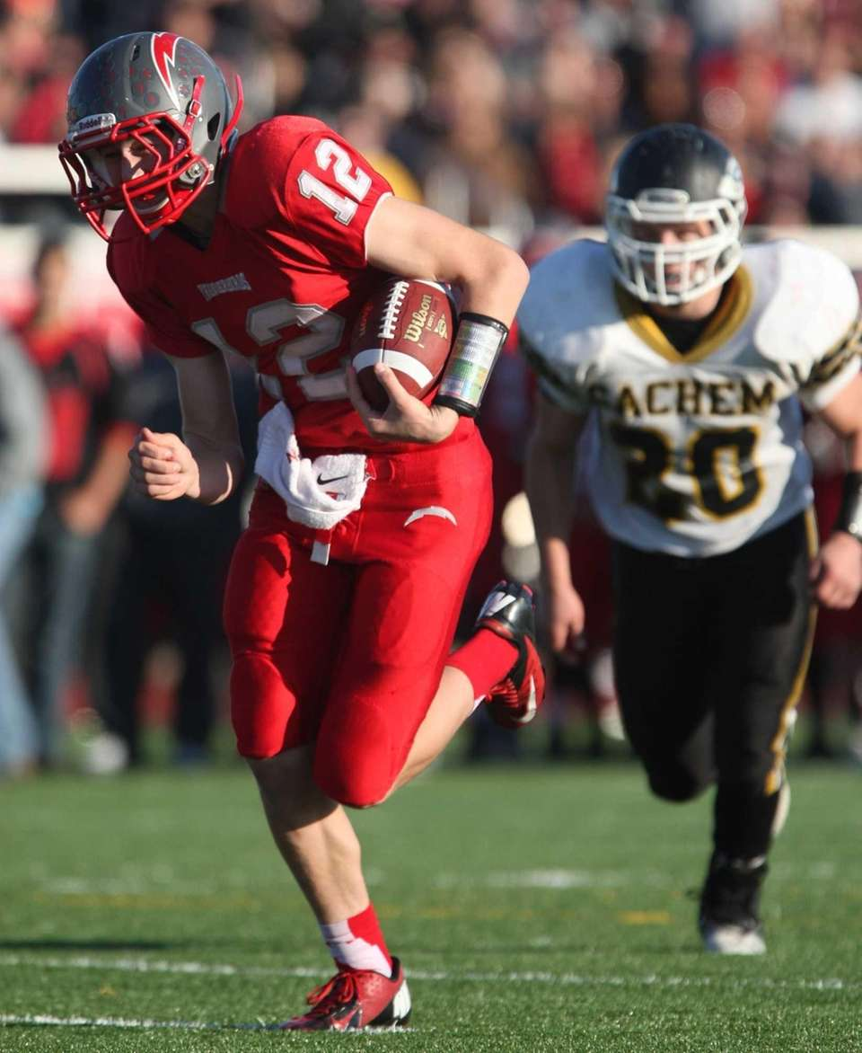 Connetquot quarterback Ricky Hahn runs the ball into
