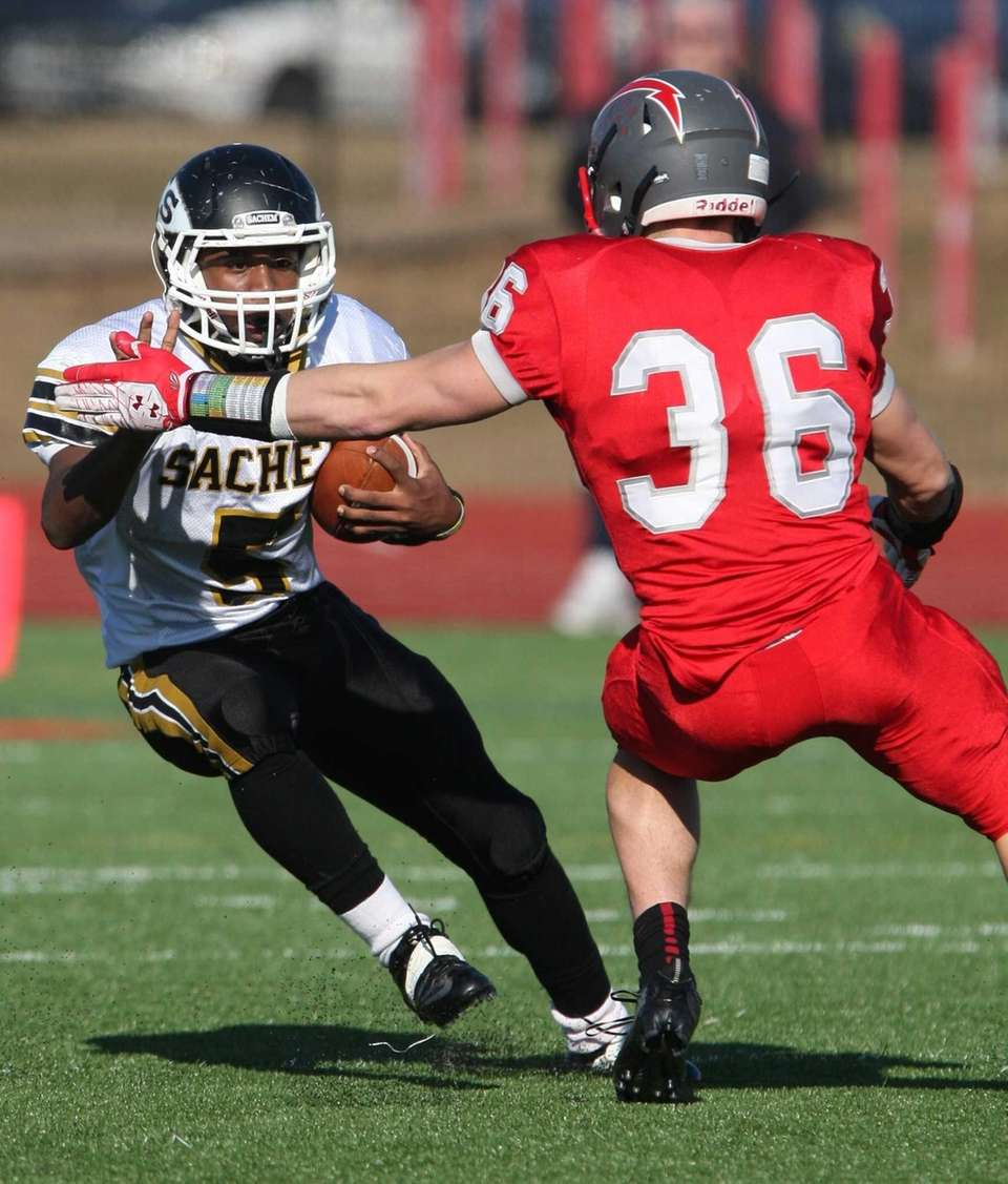 Sachem North's Malik Pierre tries to get by