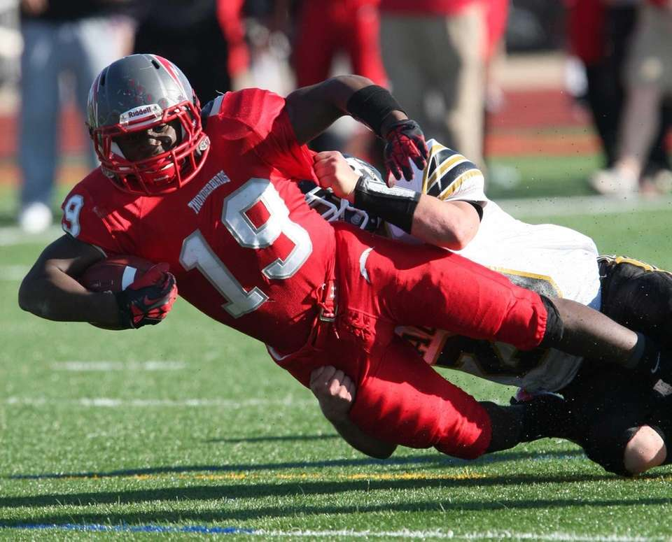 Connetquot's Marcus Gutierrez carries the ball up field