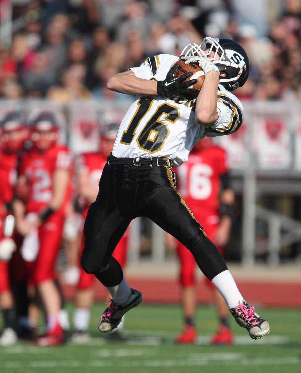 Sachem North's Jake Slater pulls a pass down