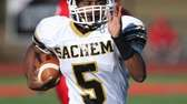 Sachem North's Malik Pierre runs the ball and