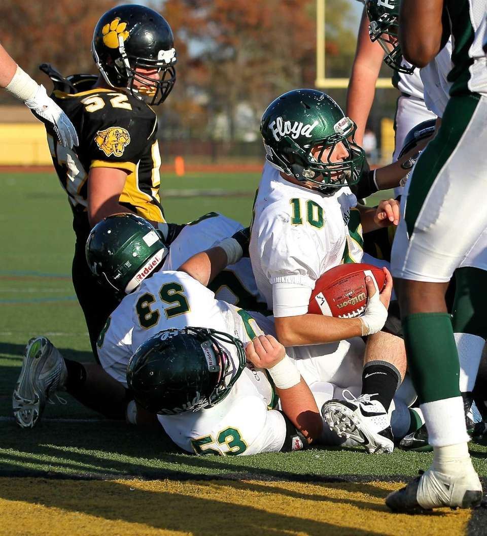 William Floyd quarterback Eric Brust (no. 10) plunges