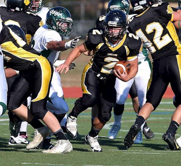 Commack running back Willy Monroy (2) finds a