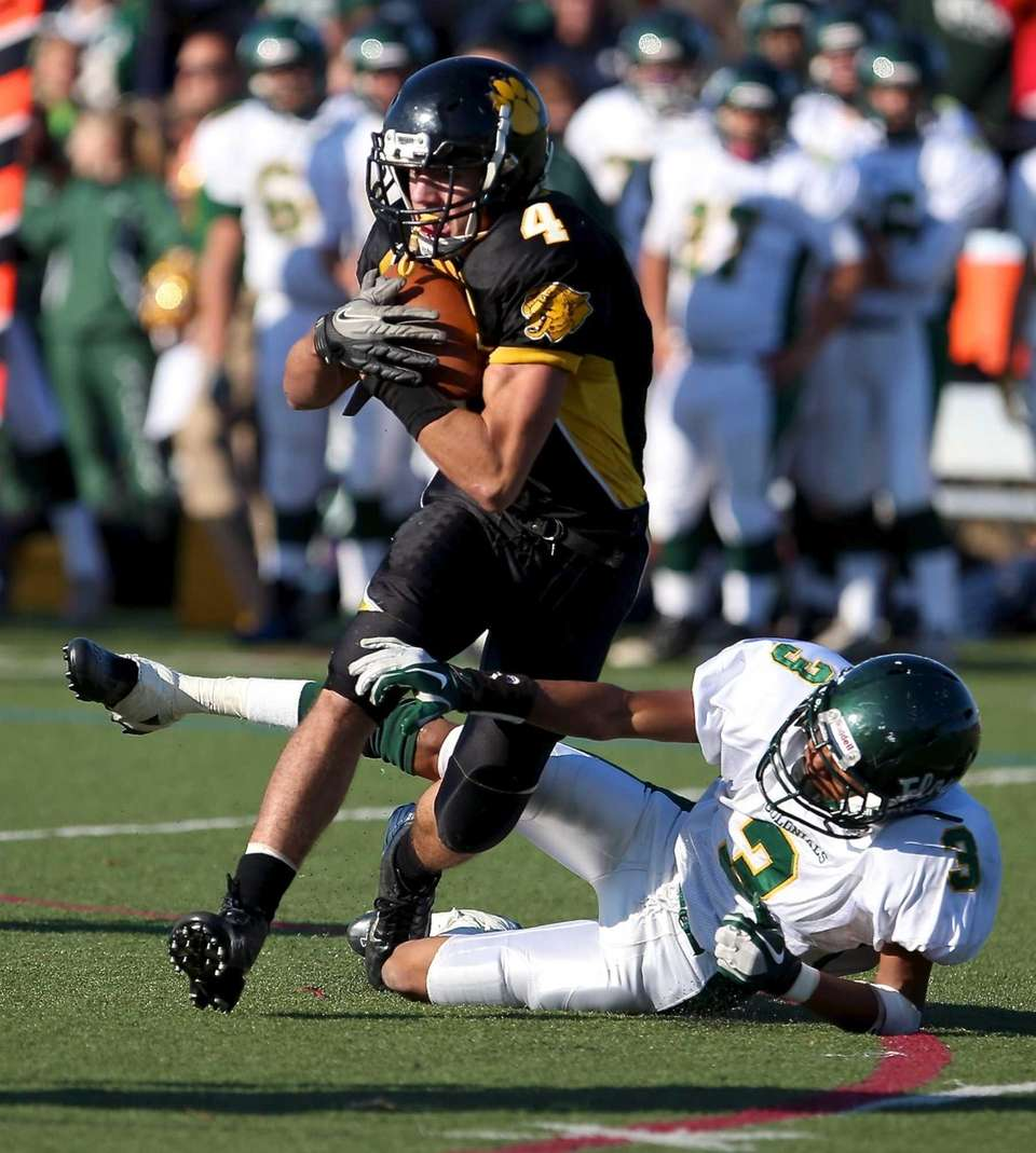 Commack wide receiver Augie Contressa (4) makes the