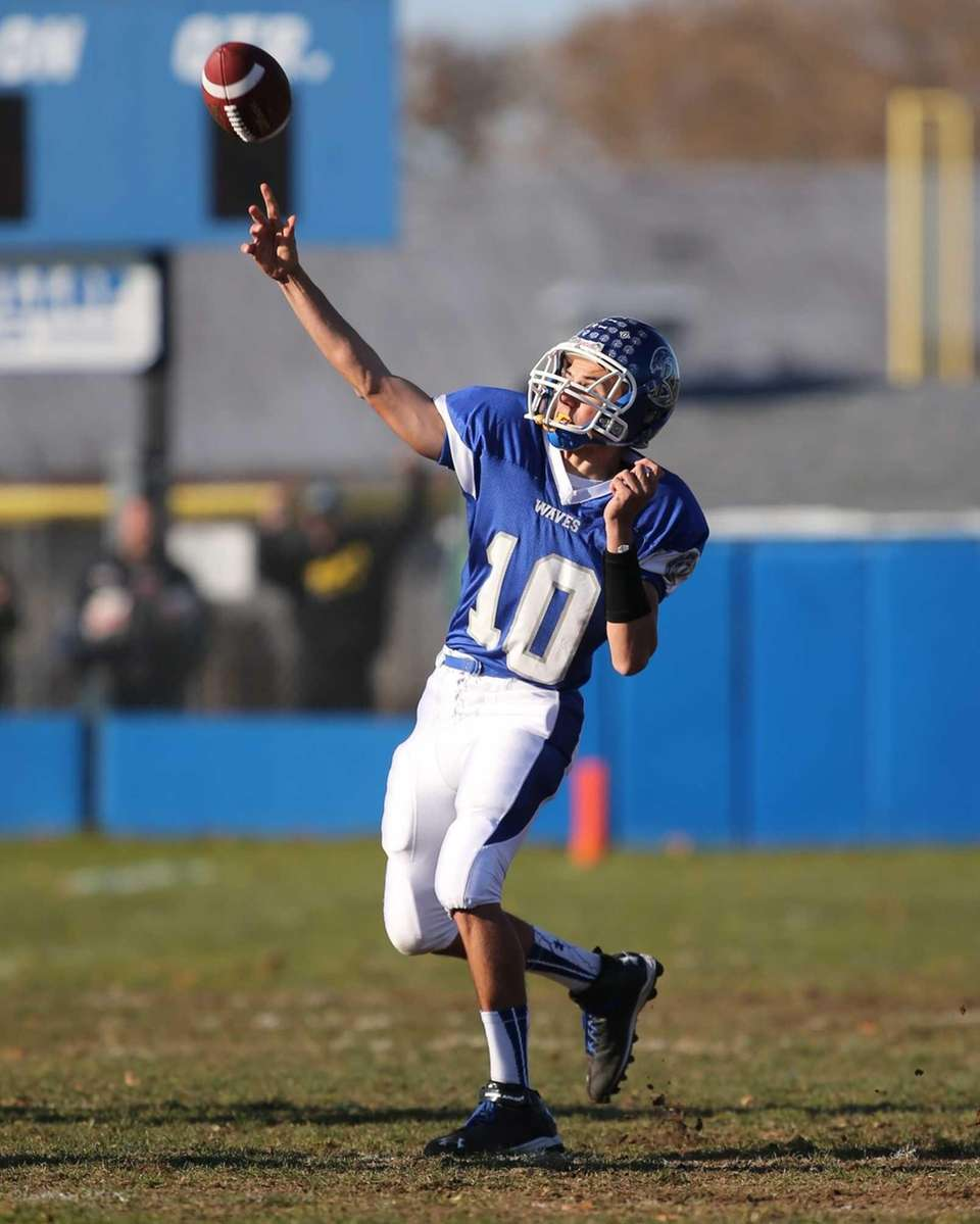 Riverhead quarterback Kenneth Simco throws a touchdown pass
