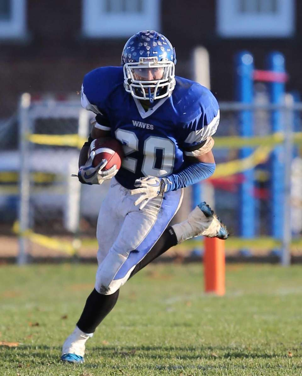 Riverhead running back Jeremiah Cheatom rushes for an