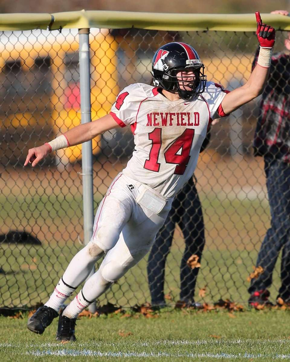 Newfield quarterback Dylan Harned celebrates his touchdown run