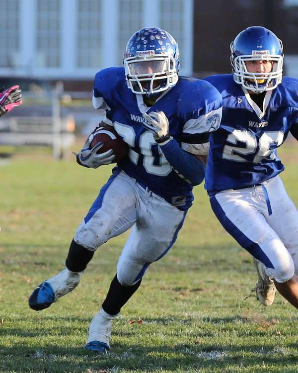 Riverhead running back Jeremiah Cheatom breaks through the