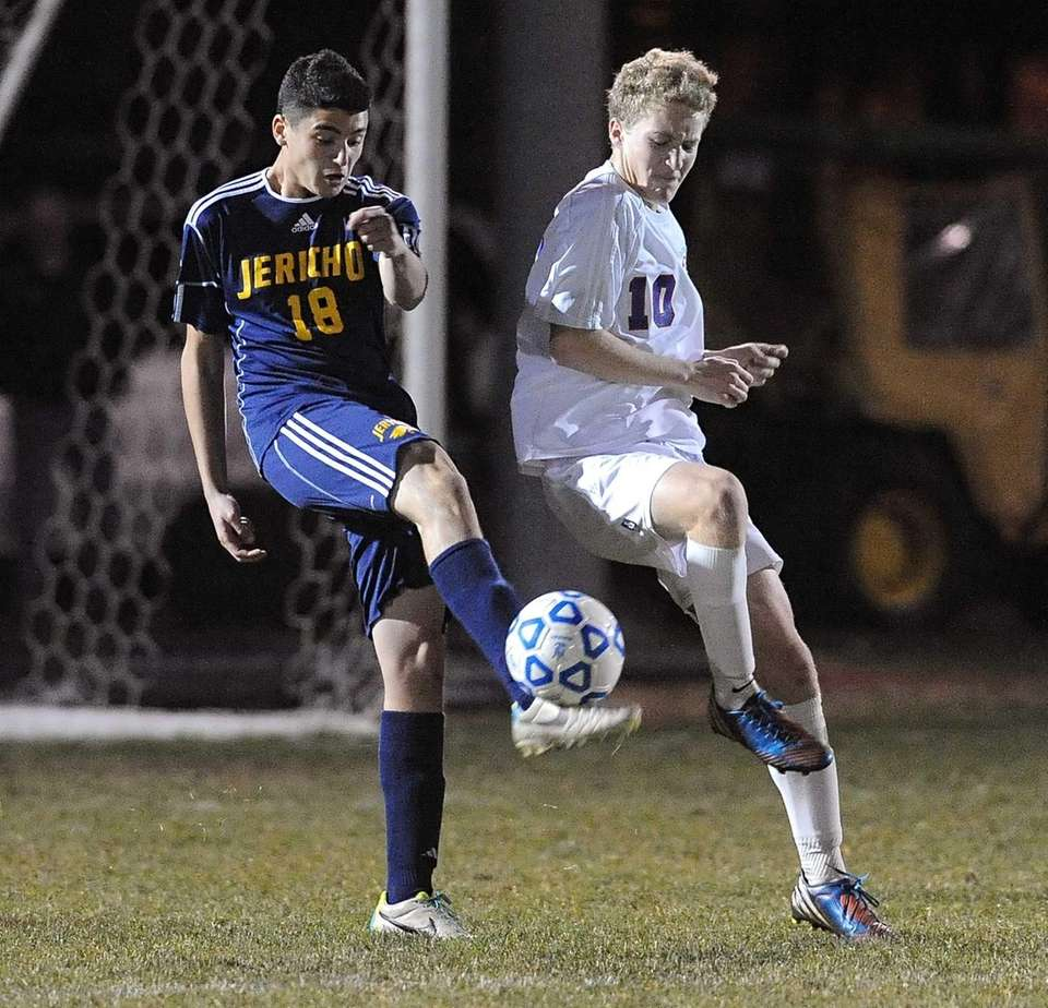 Jericho's Chase Scottland, left, clears a ball while