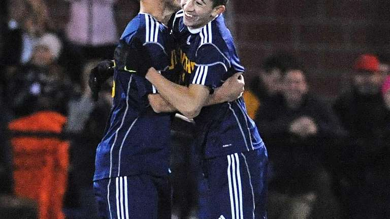 Jericho's Drew Shuman, right, celebrates his goal with