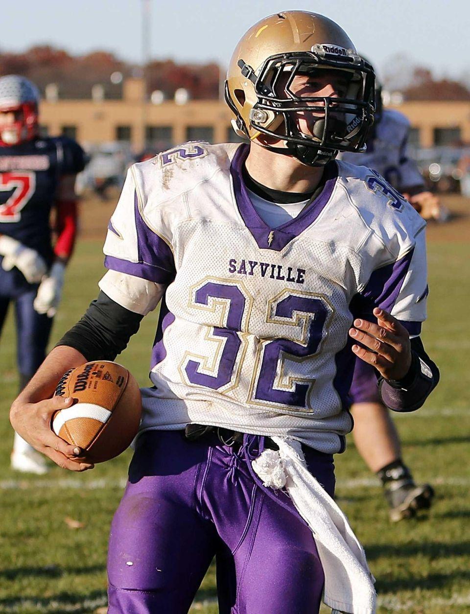 Sayville running aback Matt Selts scores a touchdown