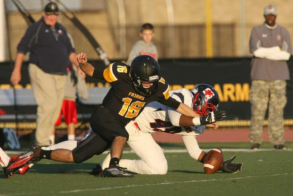 QB Stephen Genova of St Anthony's fumbles and
