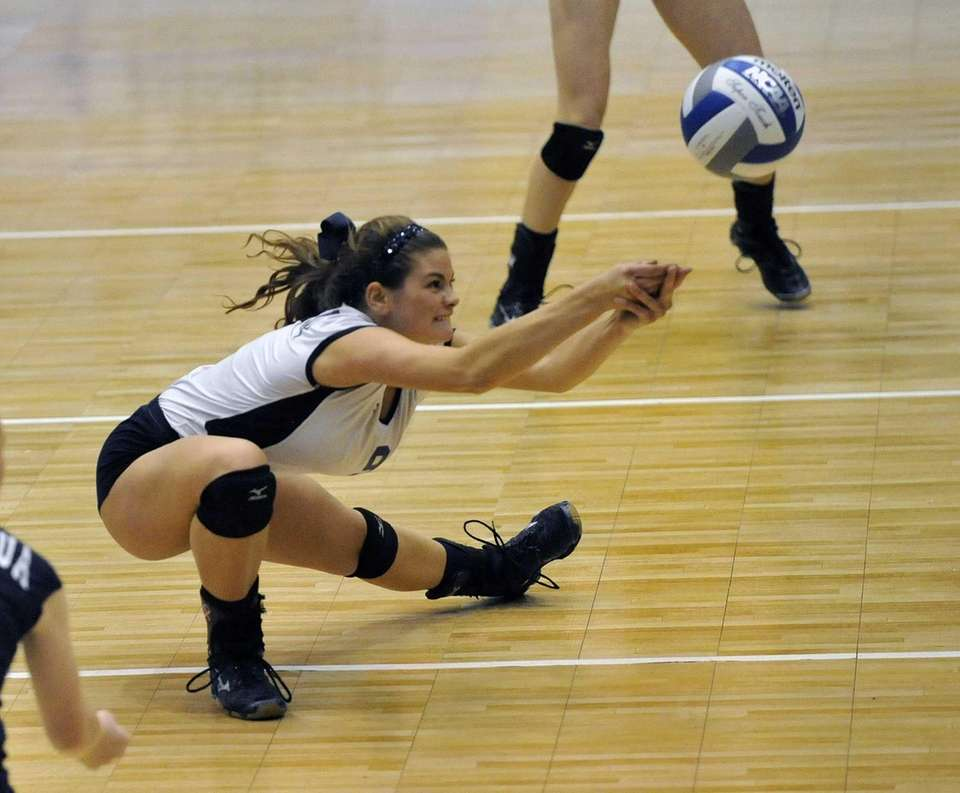Massapequa's Justine Abbate bumps the ball against Baldwinsville.