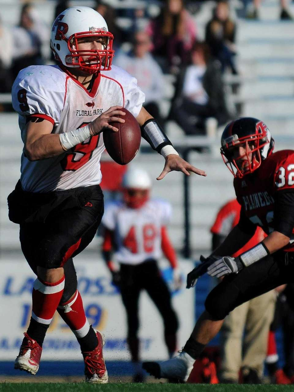 Floral Park quarterback Connor Vidasolo looks for an
