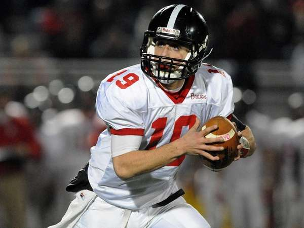 Syosset quarterback Hunter Gross looks for an open